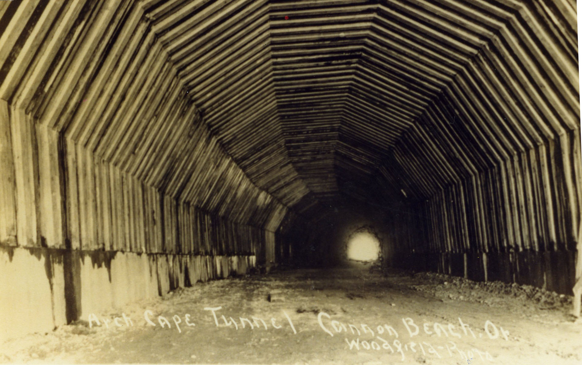 Here is another photo by Frank Woodfield of the Arch Cape tunnel with timber in place, circa 1940.