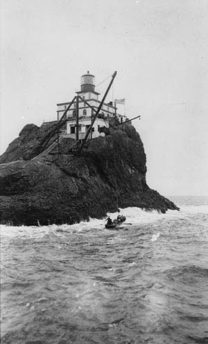 The Tillamook Rock Lighthouse receiving visitors, image taken between 1913 and 1939.